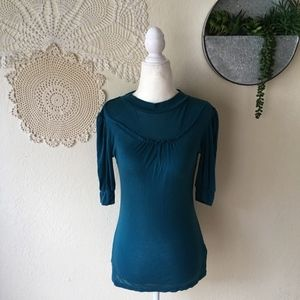 Free People teal high neck puff sleeve ribbed top